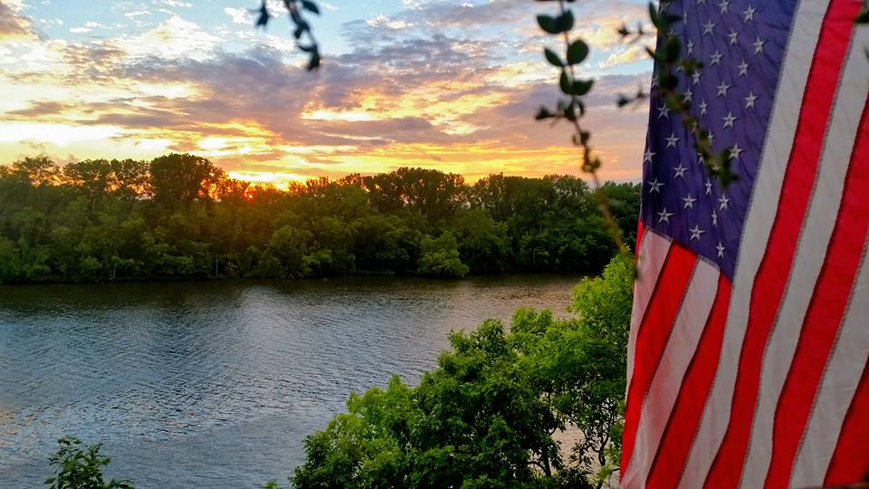 flag & sunset on the lake